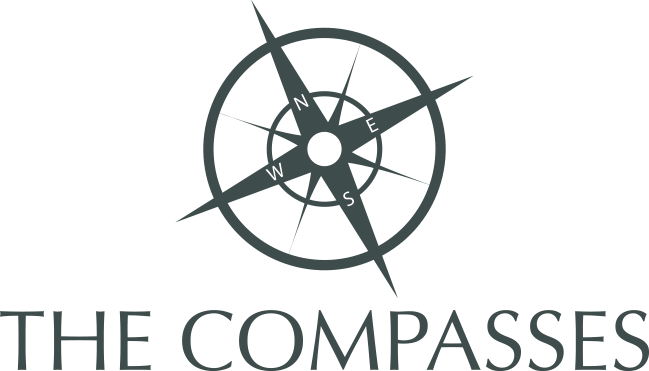 The Compasses Logo